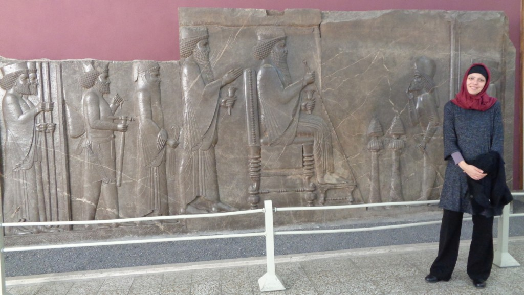 Book award winner Silvia Balatti in front of a relief from Persepolis in the National Museum of Iran.